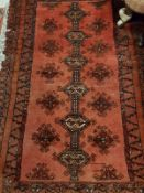 A Shirvan rug with a repeating medallion
