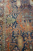 A Kashan rug with centre stylised lozeng