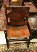 A circa 1900 oak and embossed leather th