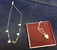 Two 9 carat gold necklaces, one with a h