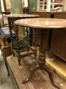 An oak tripod occasional table together