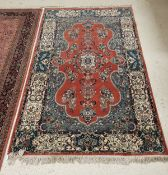 A fine Persian rug with centre medallion