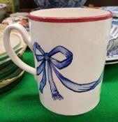 """A Wemyss """"Blue Bow"""" decorated quart mug"""