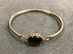A 9 carat gold set stone bangle