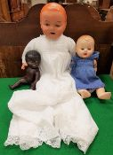 A collection of three dolls to include a