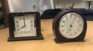 Two Smith's bakelite case electric mante