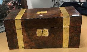 A Victorian walnut and brass bound writi