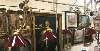 A pair of modern brass and ruby glass th