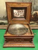A Victorian walnut cased table top polyp