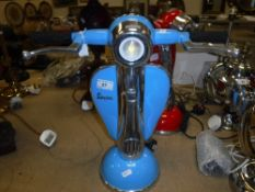 """A pale blue painted and polished metal """"Vespa"""" table lamp"""