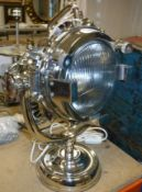 A polished metal search light type table lamp on swivel base CONDITION REPORTS A