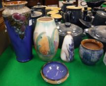 A collection of Royal Doulton vases comprising blue ground grape and vine decorated example,
