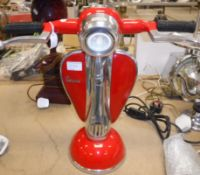 """A red painted and polished metal """"Vespa"""" table lamp"""