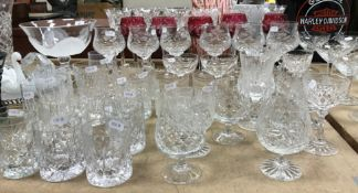 A large collection of cut glass wines and beakers to include five cranberry cut glass Bohemian wine