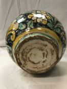 A 17th / 18th Century Sicilian maiolica albarello , bearing coat of arms to front, approx 25.