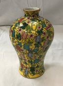 A circa 1900 Chinese Qing Dynasty porcelain Meiping style vase decorated with fruits,