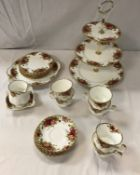 """A Royal Albert """"Old Country Roses"""" part tea service comprising three tier cake stand, cake plate,"""