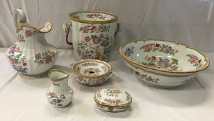 A late Victorian Cauldon china six piece floral transfer decorated toilet set,