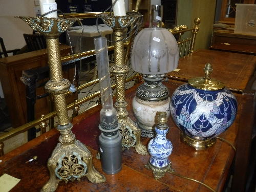 Lot 68 - A pair of pierced brass Continental table lamps,
