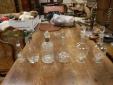 A Victorian cut glass decanter of pinched form with silver collar,