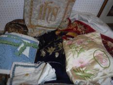 A box of assorted altar cloths to include embroidered panels,