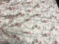 A pair of silk cream ground multi-coloured floral decorated interlined curtains with taped pencil