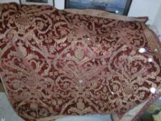 A 19th Century velvet red and gold tablecloth with tasselled edge and bird and foliate decoration