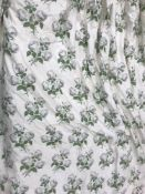 A pair of glazed cotton interlined curtains, the cream ground with white rose spray decoration,