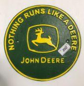 """A painted cast metal sign """"Nothing Runs a Deere - John Deere"""""""