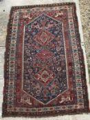 A fine Qashqai tribal rug with three rep