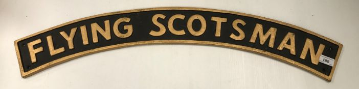 """A large cast metal and painted """"Flying Scotsman"""" name plate (reproduction)"""