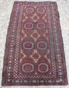 A Turkamen tribal rug with repeating ele