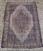 A Caucasian rug with blue stylised medallion decorated lozenge shaped medallion on a fawn / cream