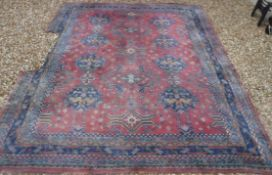 A Persian rug with all over floral medal