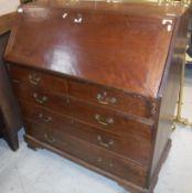 A George III mahogany oak bureau, the sl