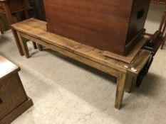 A waxed and stained pine bench seat in t
