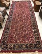 A Sarouk rug with all over scrolling flo