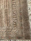 A Bokhara rug with central repeating rec
