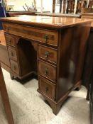 A burr walnut kneehole desk in the early