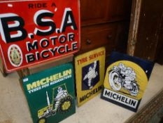 """A collection of four reproduction metal signs including """"Ride a B.S.A."""