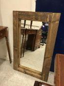 A rustic pine rectangular framed wall mi
