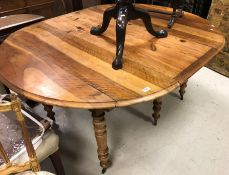 A pine and walnut D end dining table Si