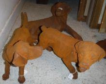 Three cast iron dogs.