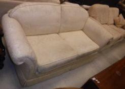 A cream floral upholstered two seat sofa