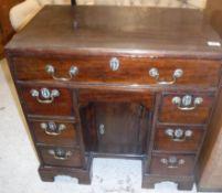 A George III mahogany kneehole desk, the