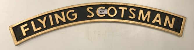 """A small painted cast metal """"Flying Scots"""