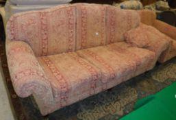 A modern terracotta / gold upholstered f