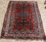A Shiraz tribal carpet with three repeat