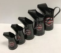 """A set of five modern graduated painted metal oil cans bearing labels """"Harley Davidson Motocycles"""