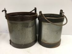 Two large galvanised and studded steel swing handled buckets